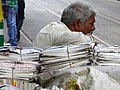 Man with Bundled Newspapers - BBD Bagh District - Kolkata - India (12304056183).jpg