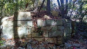 Annandale, Virginia - Stone bridge abutment for unfinished Manassas Gap Railroad crossing Indian Run Creek, located in Poe Terrace Park, Annandale, Virginia, USA.