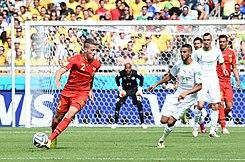 3f2536ed8dc Belgian defender maneuvering around the Algerian goal