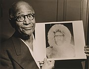 Henson in 1953, holding a portrait of Robert E. Peary