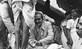 Meher Baba washing feet of poor.jpg