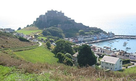 Mont Orgueil dominates the small harbour of Gorey and guards Jersey from attack from the French coast opposite Mont Orgueil castle Jersey.jpg