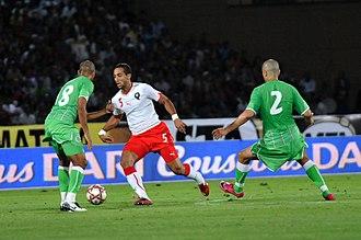 Medhi Benatia - Benatia (in white) playing against Algeria in June 2011
