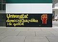Mural universitat democràtica pública i de qualitat UPF.jpg