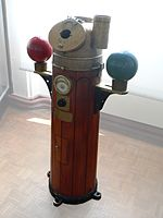 A binnacle containing a ship's steering compass, with the two iron balls which correct the effects of ferromagnetic materials