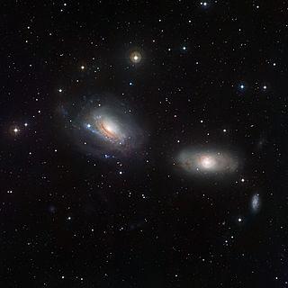 Interacting galaxy individual galaxy whose gravitational field disturbs another galaxy