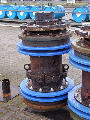 Pigging - A cleaning pig for a 28-inch oil pipeline. The blue plastic disks seal against the inside of the pipe to propel the device and to remove loose sedimentation or scale buildup. The black rectangles at the top and the circular disks in the center are magnets to attract and remove any loose metal objects in the pipe.