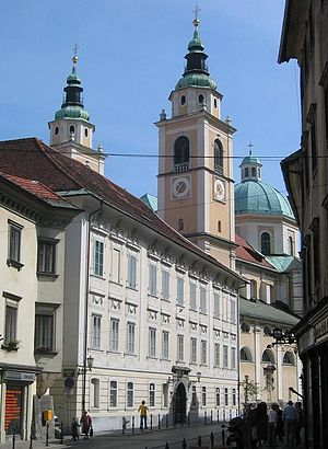 Roman Catholic Archdiocese of Ljubljana - The Bishop's Palace at Cyril and Methodius Square. In the background, Ljubljana Cathedral.