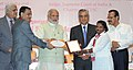 Narendra Modi felicitating the best district legal service authority and para-legal volunteers from each region and national level, at the observance of Legal Services Day and Commendation Ceremony (7).jpg