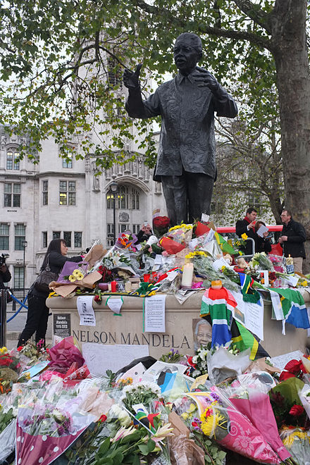Flowers left at the Mandela statue in London's Parliament Square following his death Nelson Mandela tributes in Parliament Square - London - DSCF0404.jpg