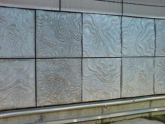 New Lynn railway station - Wall panels in the trench are to evoke both land contours and clay works / pottery heritage of the New Lynn area.