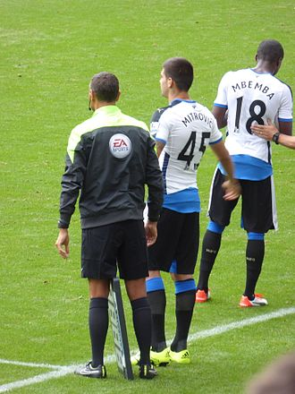 Aleksandar Mitrović (footballer) - Mitrović preparing for his Newcastle debut. He was booked 22 seconds later.