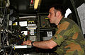 Norwegian signals captain seated w switching gear.jpg