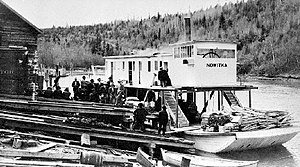 Nowitka (sternwheeler) loading at Golden, BC for first river trip 1911.JPG