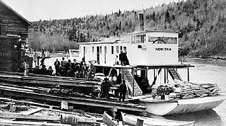 Nowitka - Image: Nowitka (sternwheeler) loading at Golden, BC for first river trip 1911