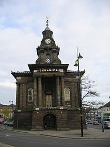Burslem Town Hall, a stone building adorned with a golden angel on its tower. The Hall was the scene for many debates and ballots during the Federation process