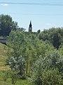 Our Lady of Hungary Church tower from Zagyva floodplain, 2017 Szolnok.jpg