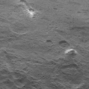 Bright spots on Ceres - Bright spot near Ahuna Mons, the tallest mountain on Ceres, whose north face also features bright material - north is up (6 June 2015)