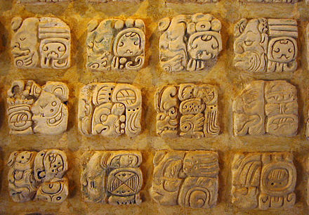 Maya glyphs in stucco at the Museo de sitio in Palenque, Mexico Palenque glyphs-edit1.jpg