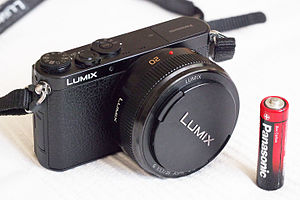 Micro Four Thirds system - Smallest mirrorless interchangeable lens camera, Panasonic GM1 side by side with AA battery.