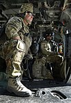 Pararescueman train with Army, military canines (9242365234).jpg