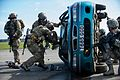 Pararescuemen assigned to the 57th Rescue Squadron use the Jaws of Life to tear apart a vehicle's roof to remove a mock victim.jpg