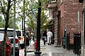Pedestrians walk in Cohoes, New York's business district.jpg