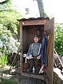 Pit latrine with funny user in an amusement part in Germany (4636245981).jpg