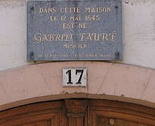 Wall plaque with French text on it
