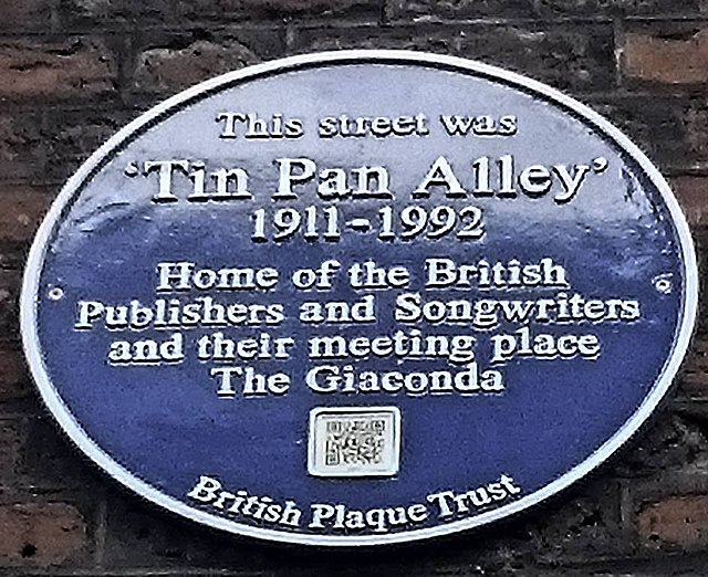 Blue plaque № 31504 - This street was 'Tin Pan Alley' 1911-1992 home of the British publishers and songwriters and their meeting place The Giaconda