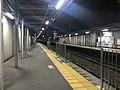 Platform of Kyusandai-mae Station at night 2.jpg