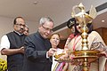 Pranab Mukherjee lighting the lamp to inaugurate the XXVII Accountants' General Conference on the theme 'Promoting Good Governance and Accountability through Public Audit' organised by the Comptroller and Auditor General of.jpg