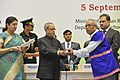 Pranab Mukherjee presenting the National Award for Teachers-2013 to Shri Mito Riba, Arunachal Pradesh, on the occasion of the 'Teachers Day', in New Delhi. The Union Minister for Human Resource Development.jpg