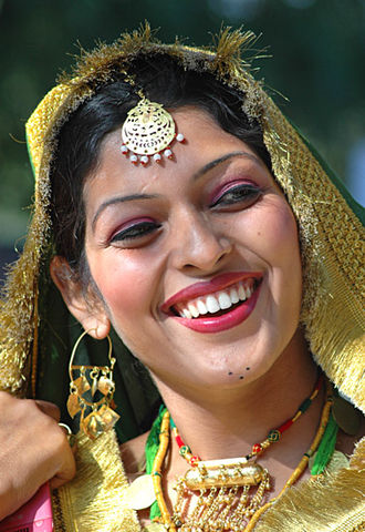 Punjabi woman waiting to participate in Gidda Punjabi woman smile.jpg