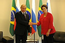 Putin shakes hands with Dilma Rousseff 2014.jpeg
