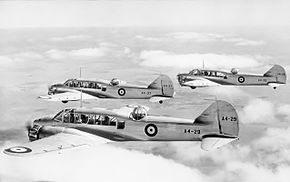 Three twin-engined military monoplanes in flight