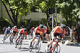 Rally Cycling leads the field in the finishing laps in Sacramento (34865750931).jpg