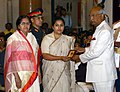 Ram Nath Kovind presenting the Shaurya Chakra to Major Gosavi Kunal Munnagir (Posthumous) the award received by his wife Smt. Uma K. Gosavi and mother Smt. Varunda M. Gosavi, at the Defence Investiture Ceremony-II.JPG