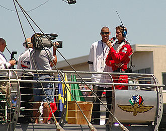 Reggie Miller - Miller waves the green flag at the 2005 Indianapolis 500, days after his final game with the Pacers