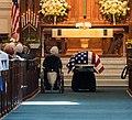 Roberta McCain beside her son John's casket (30567777018).jpg