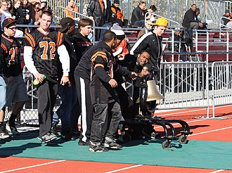 Kirkwood–Webster Groves Turkey Day Game - The Varsity football team rolls in the Frisco Bell to the 2011 Turkey Game at E. L. Lyons Memorial Stadium in Kirkwood
