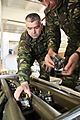 Romanian army Maj. MihaI Irminia and a fellow soldier inventory multiple integrated laser engagement system parts during a mission rehearsal exercise (MRE) at the Joint Multinational Readiness Center 130305-A-ZD093-006.jpg