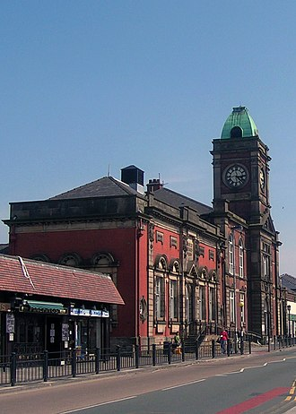 Royton - Royton Town Hall: the half-sized clock face on the eastern facade is said to have been a result of civic rivalry with neighbouring Shaw and Crompton.