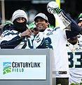 Russell Wilson, Marshawn Lynch with Lombardi Trophy (cropped).jpg