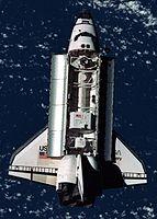 1998年6月,发现号航天飞机执行STS-91任务将AMS-01送入太空。图为置放于酬载舱后方的AMS-01。