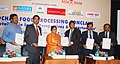 "Sadhvi Niranjan Jyoti receiving a report on ""Food Retailing in India Perspectives and Opportunities"" from the Chairman, Southern Regional Council, Mr. Ravi Sana Reddy, at a conclave, organised by ASOCHAM, in Chennai.jpg"