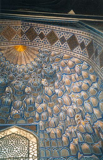 Gur-e-Amir - Inside the mausoleum – deep niches and diverse muqarnas decoration.