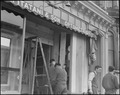 San Francisco, California. Owners of Japanese ancestry board windows of their stores on Post Street . . . - NARA - 536455.tif