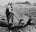 Sara Fina Tafoya firing blackware pottery at Santa Clara Pueblo, c. 1900.jpg