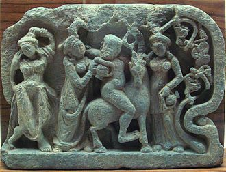 Satyr - Satyr on a mountain goat, drinking with women, in a Gandhara relief of 2nd–4th century CE